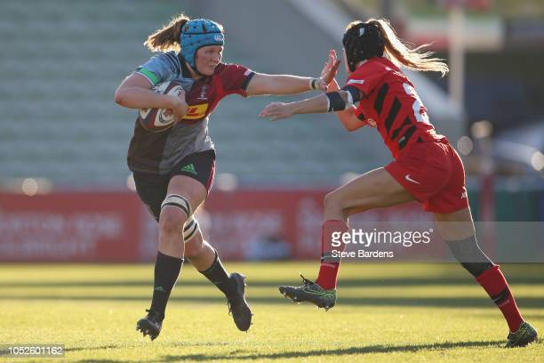Fiona Fletcher of Harlequins Ladies hands off Kay Searcy of Saracens Women during the Tyrrells Premier 15s match between Harlequins Ladies and...