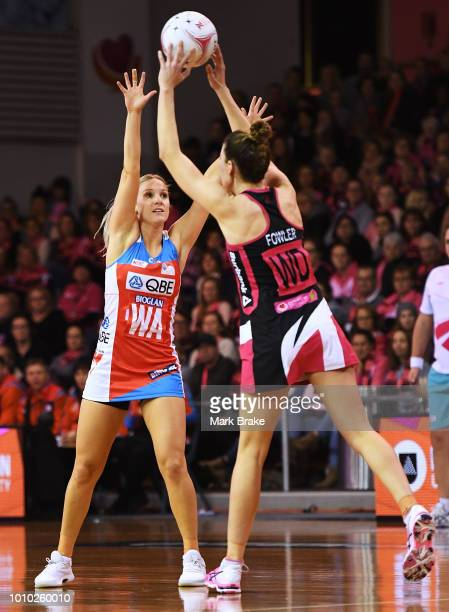 Fiona Fowler of the Thunderbirds passes over Natalie Haythornthwaite of the Swifts during the round 14 Super Netball match between the Thunderbirds...