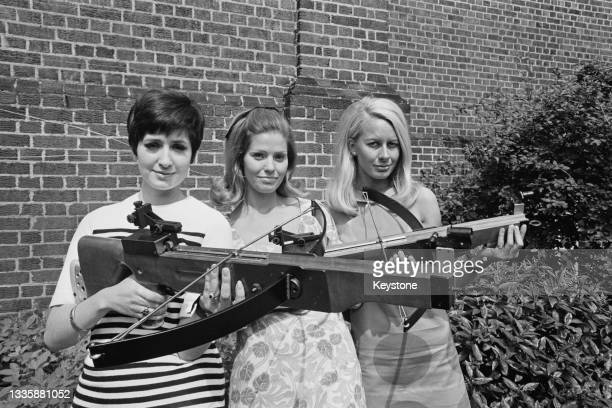 Fiona Helen, Anita Richardson, and Andrea Lloyd, three applicants for the job as a hostess on television game show 'The Golden Shot', pose together,...