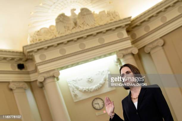 Fiona Hill the former top Russia expert on the National Security Council is swornin before she testifies during the House Intelligence Committee...