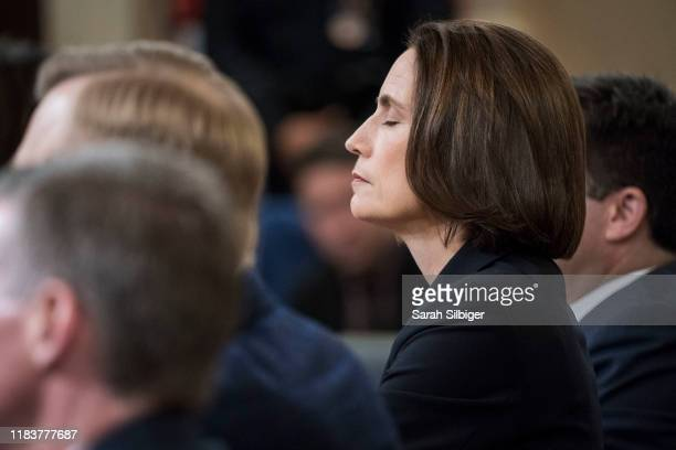 Fiona Hill the National Security Council's former senior director for Europe and Russia closes her eyes as she testifies to the House Intelligence...
