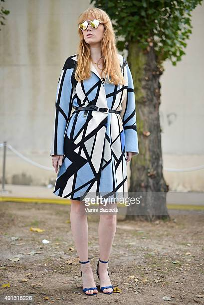 Fiona Jane poses wearing a 2ndday dress Topshop belt and Stella Luna shoes before the Celine show at the Tennis Club de Paris during Paris Fashion...
