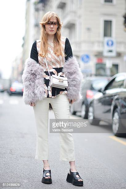 Fiona Jane poses wearing Sportmax top pants and shoes St Tropez fur Prada bag and Loewe sunnies before the Sportmax show during the Milan Fashion...