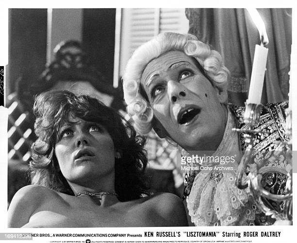 Fiona Lewis and John Justin looking up in a scene from the film 'Lisztomania', 1975.