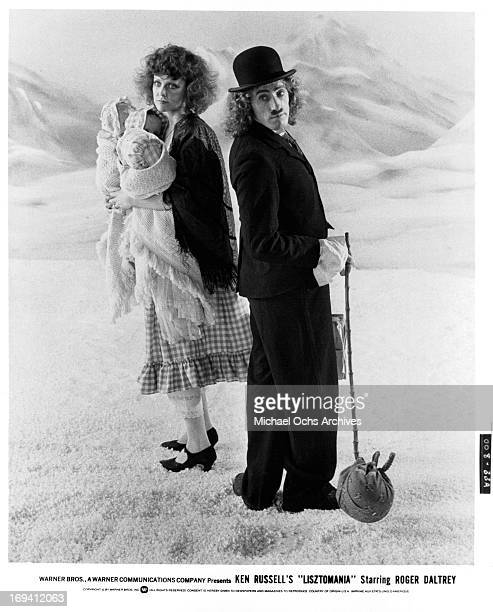 Fiona Lewis and Roger Daltrey dressed as vagabonds in a scene from the film 'Lisztomania', 1975.