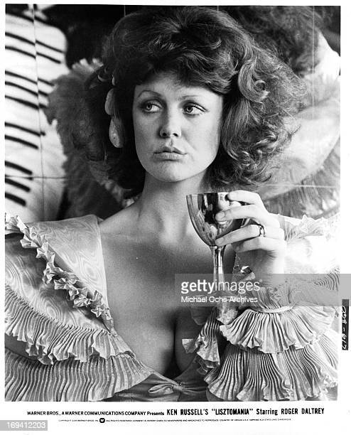 Fiona Lewis drinking from goblet in a scene from the film 'Lisztomania', 1975.