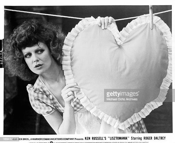 Fiona Lewis with heart pillow on clothes line in a scene from the film 'Lisztomania', 1975.