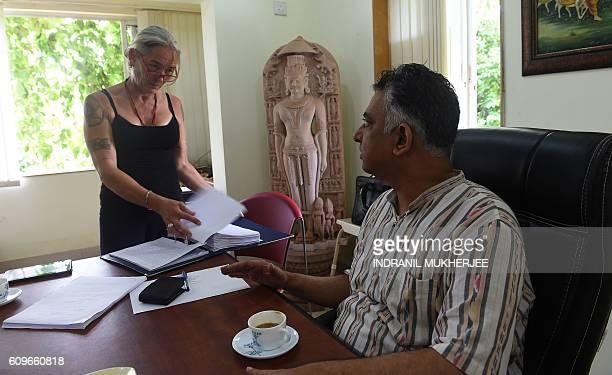 Fiona MacKeown mother of murdered British schoolgirl Scarlett Keeling speaks with her lawyer Vikram Varma in Panaji on September 22 2016 An Indian...