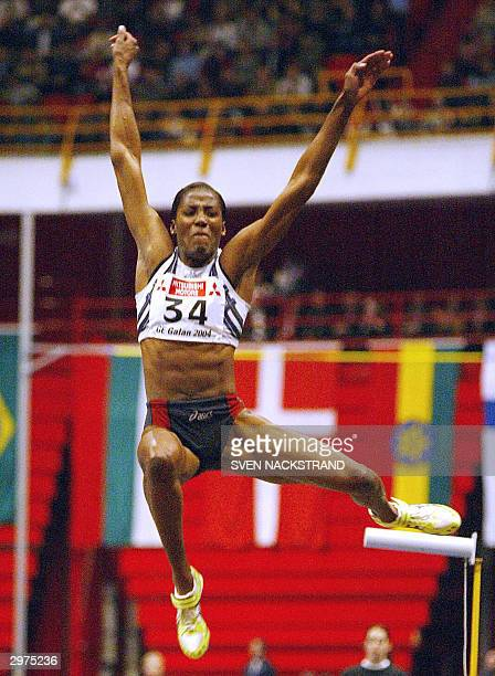 Fiona May of Italy jumps 661 meters to win the long jump in the GE Athletics Gala in Stockholm 12 February 2004 May beat Olga Rublyova and Ludmila...