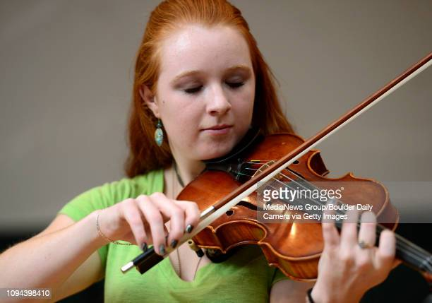 Fiona Patterson plays the violin during a rehearsal for a Sept 6th concert at Westview Presbyterian Church 1500 Hover St Friday Aug 30 2013