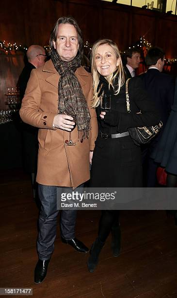 Fiona Phillips and Martin Frizell attend the Missing People Carol Service at StMartinInTheFields Trafalgar Square on December 10 2012 in London...