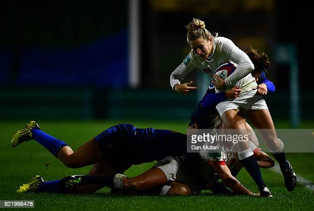 Fiona Pocock of England is tackled by Camille Grassineau of France during the Old Mutual Wealth Series match between England Women and France Women...