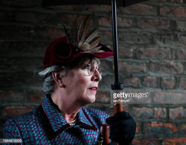 Fiona Roberts from Newtown wears period costume as she shelters from heavy rain during the North Yorkshire Moors Railway 1940's Wartime Weekend event...