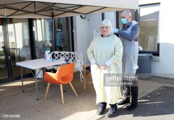 Fiona Scott , prepares to visit her mother Mary Cook at her nursing home, for the first time since the coronavirus lockdown started, in Edinburgh on...