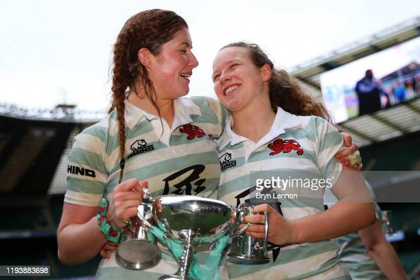 Fiona Shuttleworth celebrates with Coreen Grant of Cambridge after their team's victory in the Women's Varsity Game between Oxford and Cambridge at...
