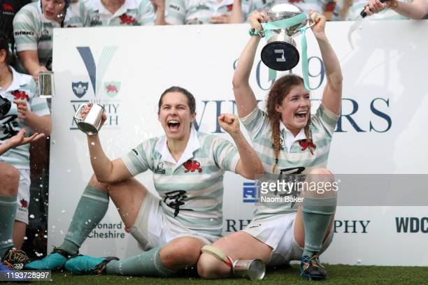 Fiona Shuttleworth of Cambridge celebrates with her team on the podium after her teams victory in the Women's Varsity Game between Oxford and...