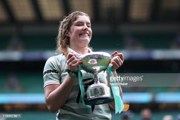 Fiona Shuttleworth of Cambridge celebrates with the trophy after her teams victory in the Women's Varsity Game between Oxford and Cambridge at...