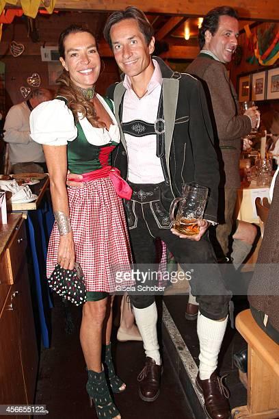 Fiona Swarovski and her husband KarlHeinz Grasser during Oktoberfest at Schuetzenzelt/Theresienwiese on October 4 2014 in Munich Germany