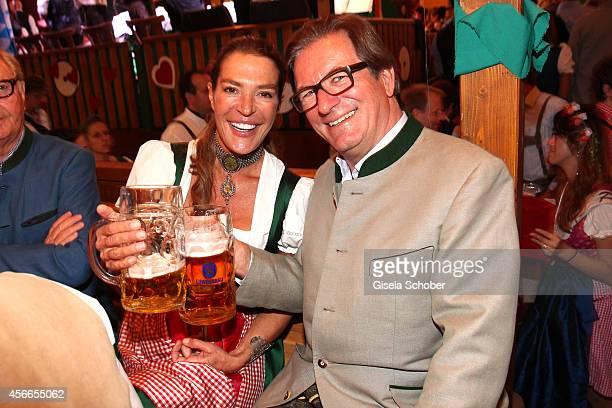 Fiona Swarovski and Thomas Haffa during Oktoberfest at Schuetzenzelt/Theresienwiese on October 4 2014 in Munich Germany