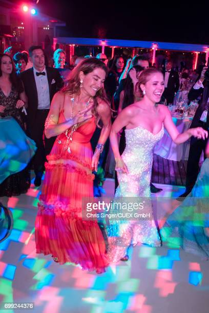 Fiona Swarovski and Victoria Swarovski dance at the wedding of Victoria Swarovski and Werner Muerz on June 16 2017 in Trieste Italy