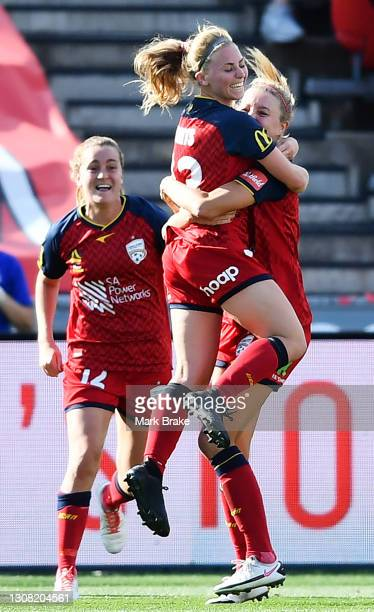 Fiona Worts of Adelaide United celebrates after scoring her teams third goal hugs Maruschka Waldus of Adelaide United during the round 13 W-League...