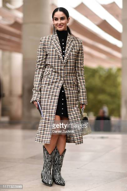 Fiona Zanetti is seen wearing a plaid Paco Rabanne coat and zebra print boots outside the Paco Rabanne show during Paris Fashion Week SS20 on...