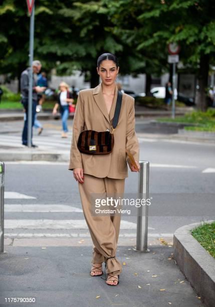 Fiona Zanetti is seen wearing beige coat Fendi bag outside the Fendi show during Milan Fashion Week Spring/Summer 2020 on September 19 2019 in Milan...