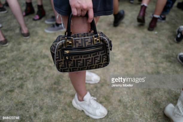 Fiona Zanetti wearing a band shirt and Fendi bag during day 3 of the 2018 Coachella Valley Music Arts Festival Weekend 1 on April 15 2018 in Indio...