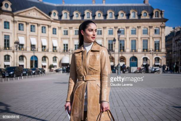 Fiona Zanetti wearing a beige leather coat and a Bally brown bag is seen in the streets of Paris before the Lanvin show during Paris Fashion Week...