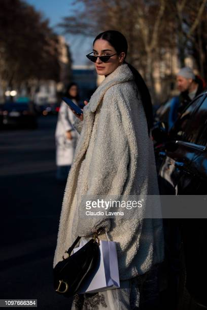 Fiona Zanetti wearing a long white fur coat and black Dior bag is seen outside Christian Dior during Paris Fashion Week Haute Couture Spring Summer...