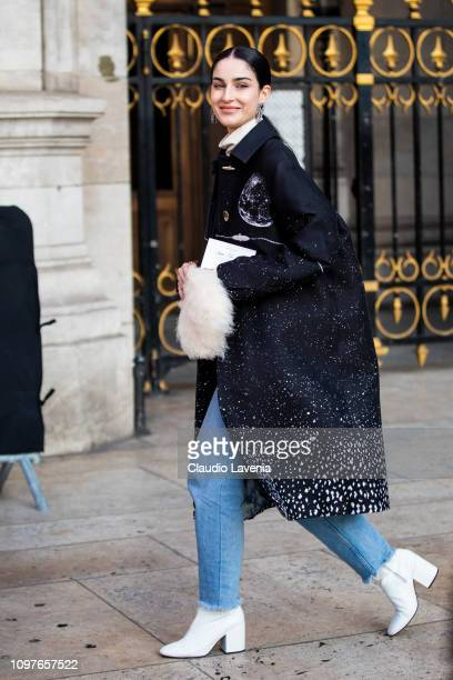 Fiona Zanetti wearing a printed coat blue jeans white boots and white fur bag is seen outside Schiaparelli during Paris Fashion Week Haute Couture...