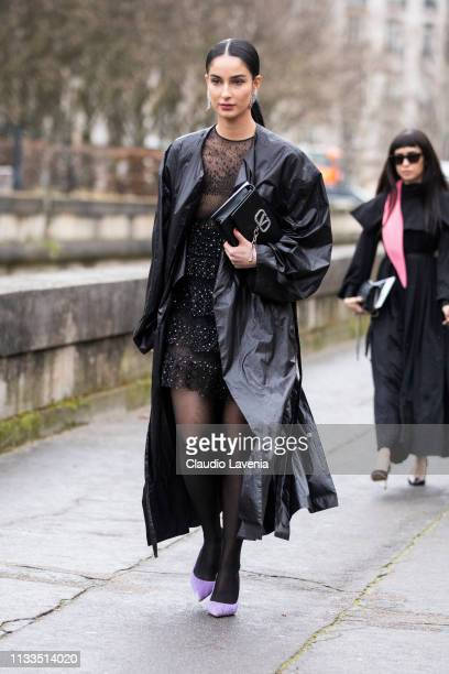 Fiona Zanetti wearing a sheer decorated black dress lilac heels black leather coat and black Valentino bag is seen outside Valentino on Day 7 Paris...