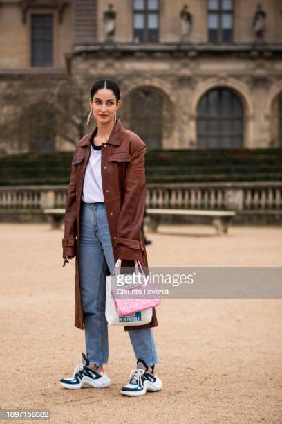 Fiona Zanetti wearing a white tshirt blue jeans Louis Vuitton sneakers pink Kenzo bag and brown long coat is seen in the streets of Paris after the...