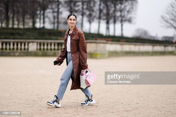 Fiona Zanetti wears a brown leather coat a pink bag sneakers outside Kenzo during Paris Fashion Week Menswear F/W 20192020 on January 20 2019 in...