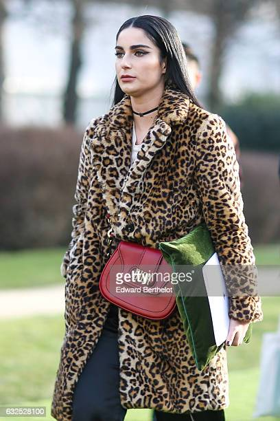 Fiona Zanetti wears a leopard print coat a Dior red bag and attends the Christian Dior Haute Couture Spring Summer 2017 show as part of Paris Fashion...