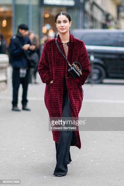 Fiona Zanetti wears a red coat outside Viktor Rolf during Paris Fashion Week Haute Couture Spring/Summer 2018 on January 24 2018 in Paris France