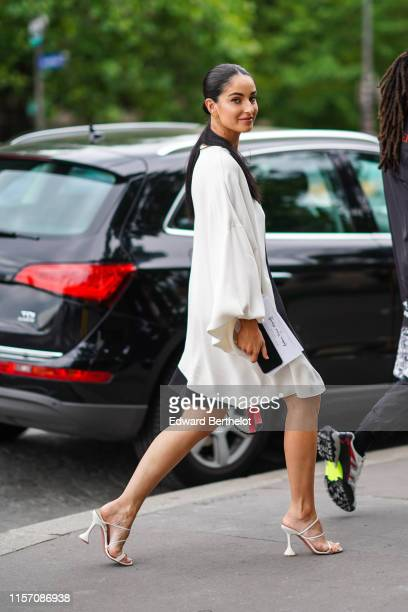 Fiona Zanetti wears a white dress earrings white shoes outside Valentino during Paris Fashion Week Menswear Spring/Summer 2020 on June 19 2019 in...