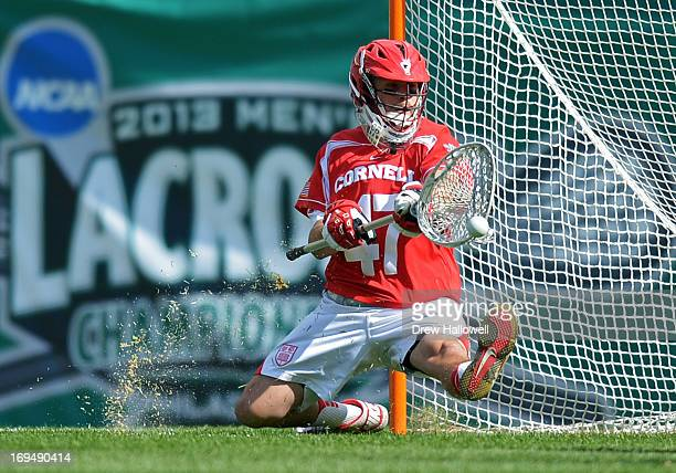 Fiore of the Cornell University Big Red drops to make a save during the game against the Duke University Blue Devils during a semifinal game of the...