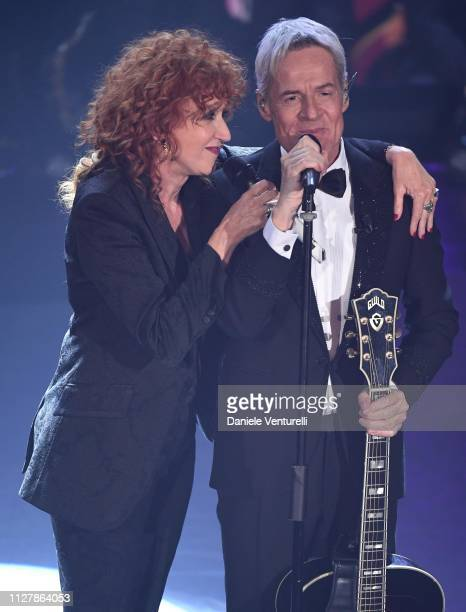 Fiorella Mannoia with host Claudio Baglioni on stage during the second night of the 69th Sanremo Music Festival at Teatro Ariston on February 06 2019...