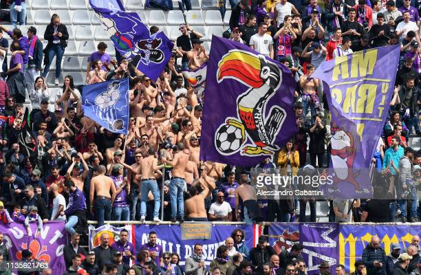 Fiorentina fans cheer for their team during the Serie A match between ACF Fiorentina and Frosinone Calcio at Stadio Artemio Franchi on April 7 2019...
