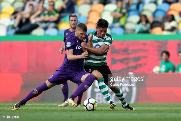 Fiorentina forward Ante Rebic from Croacia vies with Sporting CP defender Jonathan Silva from Argentina during the Five Violins Trophy match between...