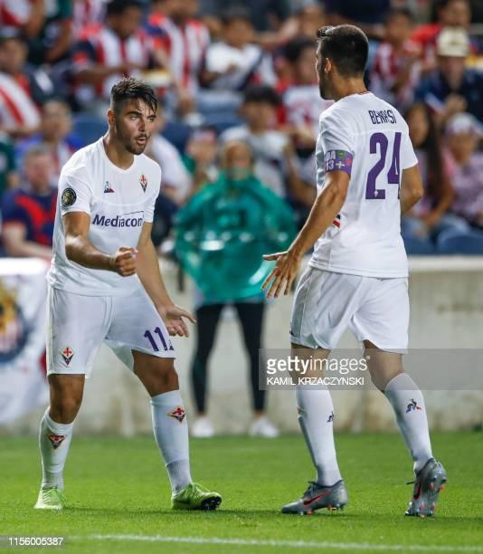 Fiorentina forward Riccardo Sottil celebrates with midfielder Marco Benassi after scoring against Chivas de Guadalajara during their 2019...