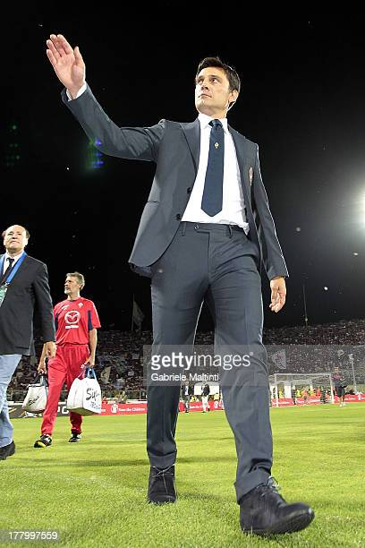 Fiorentina head coach Vincenzo Montella waves to fans as he walks on the pitch before the Serie A match between ACF Fiorentina and Calcio Catania at...