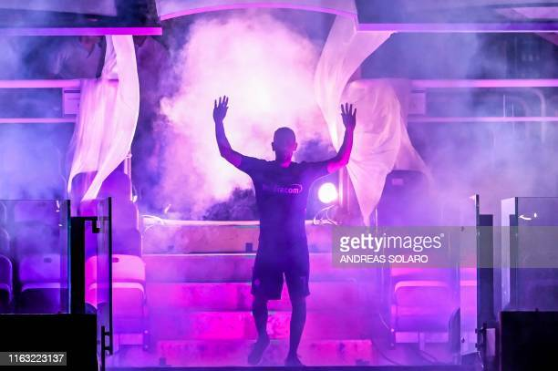 Fiorentina newly recruited players France's midfielder Franck Ribery waves during his presentation to supporters at the municipal stadium Artemio...