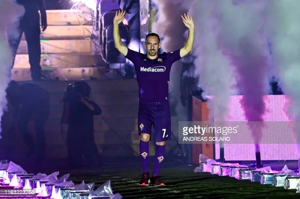 Fiorentina newly recruited players France's midfielder Franck Ribery stands during his presentation to supporters at the municipal stadium Artemio...