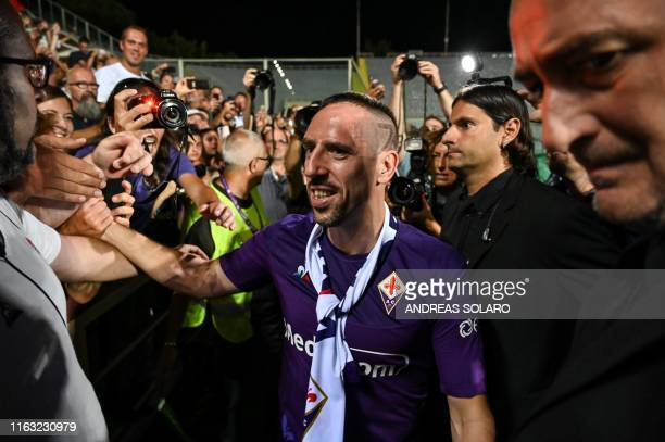 Fiorentina newly recruited players France's midfielder Franck Ribery shakes hands with supporters during his presentation at the municipal stadium...