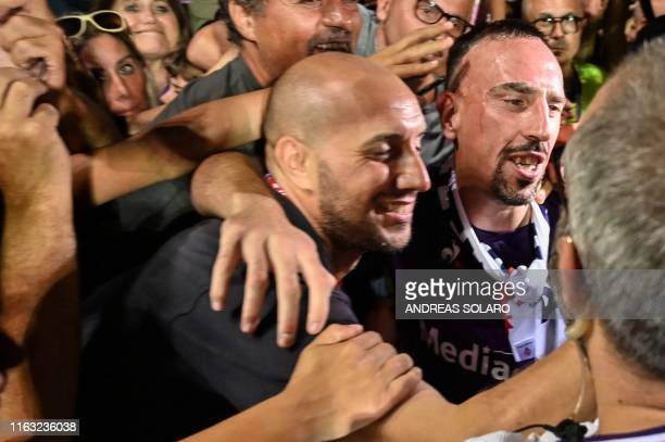 Fiorentina newly recruited players France's midfielder Franck Ribery poses for selfies during his presentation to supporters at the municipal stadium...