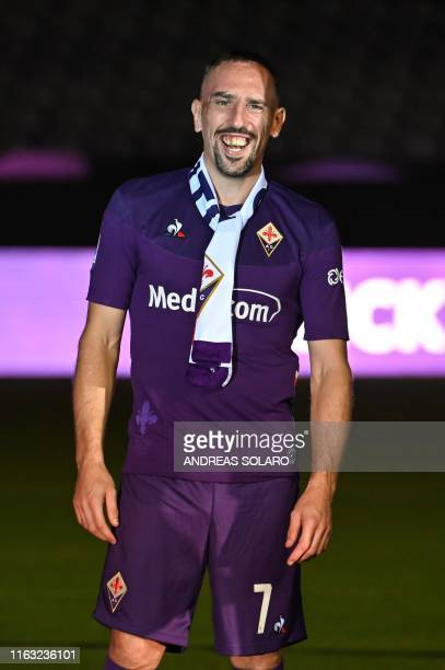 Fiorentina newly recruited players France's midfielder Franck Ribery smiles during his presentation to supporters at the municipal stadium Artemio...