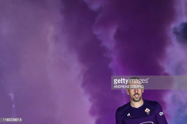 Fiorentina newly recruited players France's midfielder Franck Ribery looks on during his presentation to supporters at the municipal stadium Artemio...