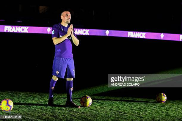 Fiorentina newly recruited players France's midfielder Franck Ribery gestures during his presentation to supporters at the municipal stadium Artemio...